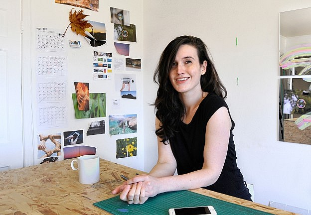 Multimedia artist Erin Mitchell in her work environment.