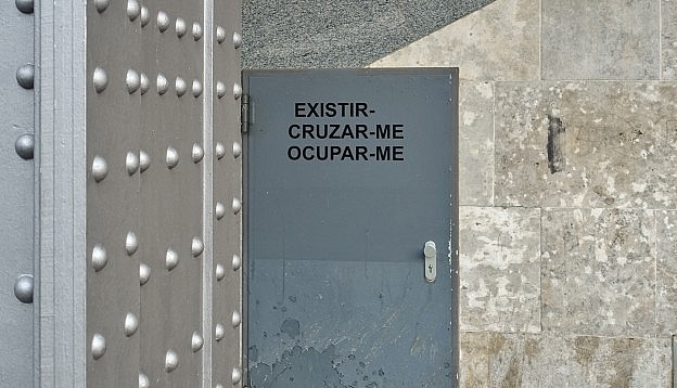 Alexandre Baptista - Social Words / ME, view of language work by the artist temporarily placed on an outside door