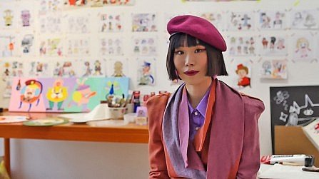 Young Korean artist Berry Kim surrounded by her drawings in her SomoS Berlin atelier.