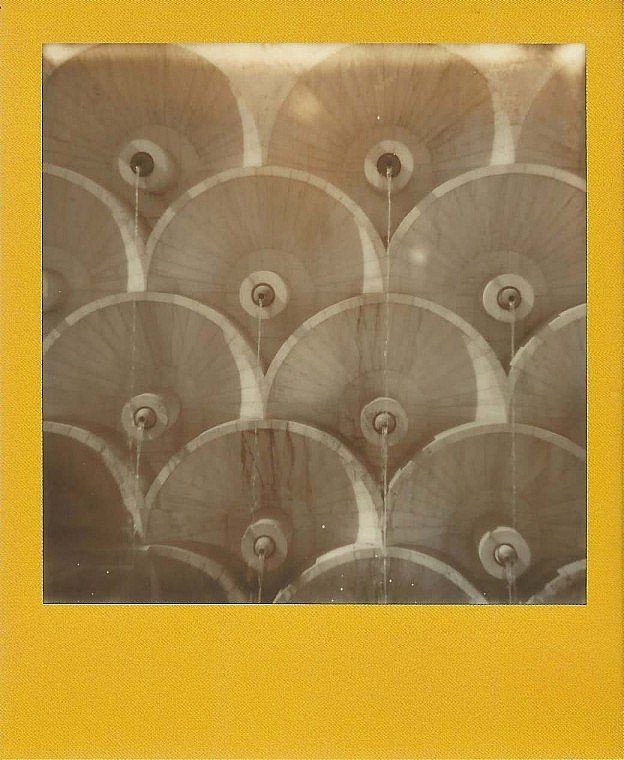 Brightly-colored special edition Polaroid of Soviet architectural detail by Elena Amabili.