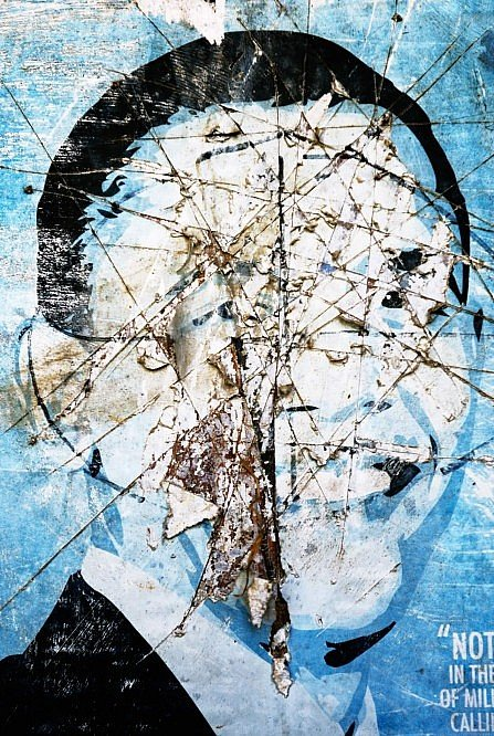 A slashed Obama poster in a photographic artwork by artist Jeff St. Andrews.