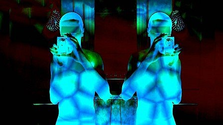Tee Un_Real Desires flyer shows a mirrored view of a semi-nude photographer with mobile phone, lit by atmospheric shimmering blue light patches.