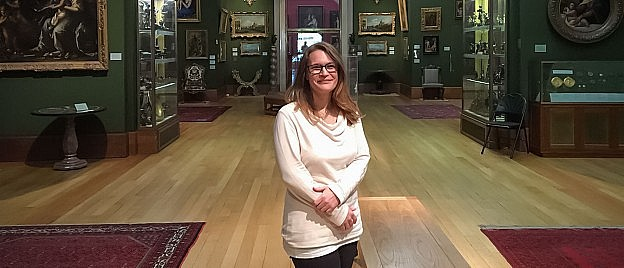 Museum engagement professional Ina Pruegel in a classical museum exhibition hall.