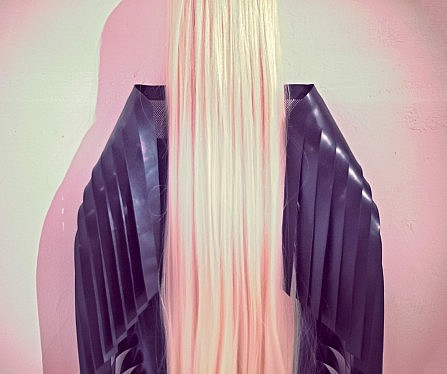 Menacing sculpture out of latex and hair at the Un_Real Desires exhibition.